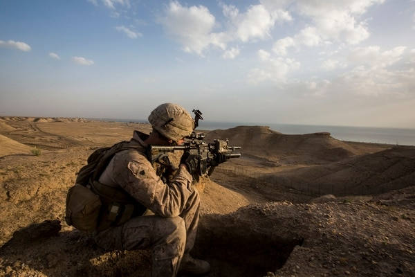 U.S. Marine Sgt. Josh Greathouse, a team leader with Company B, 1st Battalion, 7th Marine Regiment, Special Purpose Marine Air Ground Task Force - Crisis Response - Central Command (SPMAGTF-CR-CC), scans the area during a perimeter patrol in Al Taqaddum, Iraq, March 21, 2016. SPMAGTF-CR-CC Marines are responsible for the force protection of coalition assets at some Combined Joint Task Force – Operation Inherent Resolve bases within the U.S. Central Command area of responsibility as part of the effort to defeat the Islamic State of Iraq and Levant. (U.S. Marine Corps photo by Sgt. Rick Hurtado / RELEASED).