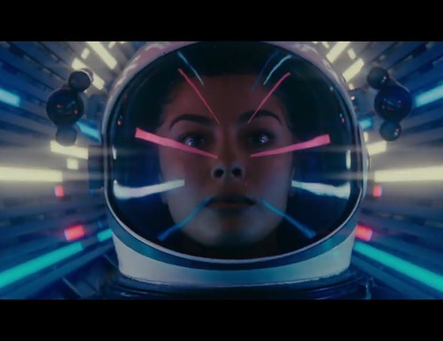 A still from a U.S. Space Force recruiting ad shows a service member in what appears to be an astronaut helmet. (U.S. Space Force)