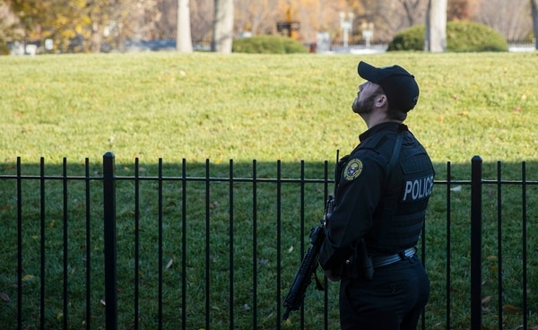 A uniformed Secret Service officer patrols the White House grounds during a lockdown due to an airspace violation Tuesday in Washington. (Evan Vucci/AP)