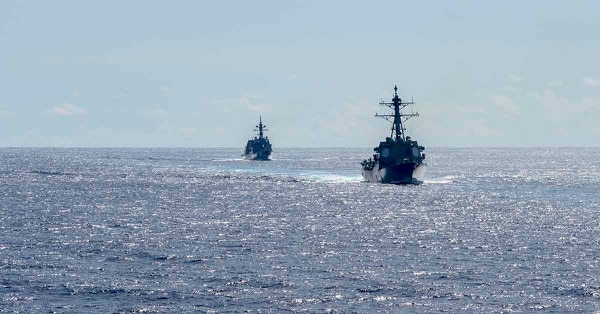 The Navy names two new Arleigh Burke-class destroyers after Vietnam War Marine Corps veterans. Above, two destroyers line in a formation during a missile exercise. (MC3 Sarah Myers/Navy)