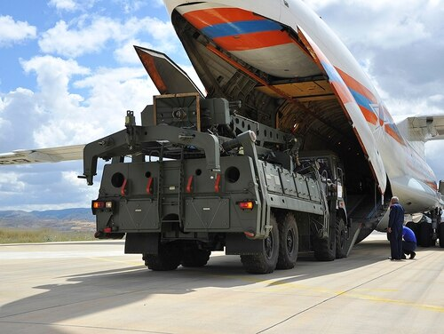 Parts of the S-400 air defense system are unloaded from a Russian transport aircraft at Murted military airport in Ankara, Turkey, on July 12, 2019. (Turkish Defence Ministry via AP)