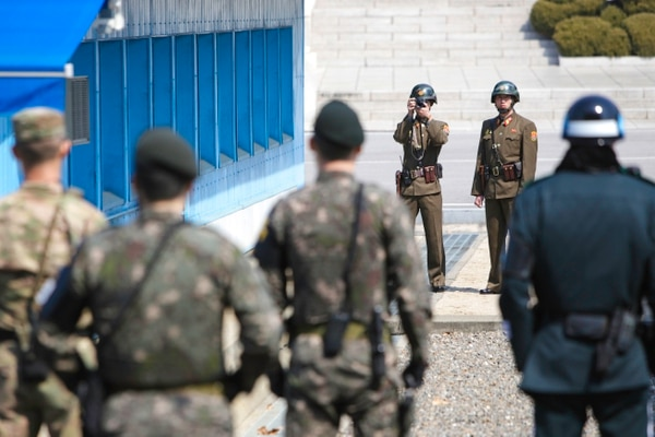 Service members of the North Korean People's Army photograph and look on as Gen. Vincent Brooks, U.S. Forces-Korea commander, and then-Secretary of State Rex Tillerson visit the Joint Security Area inside the Korean Demilitarized Zone, Mar. 17, 2017. (Sgt. 1st Class Sean K. Harp/Army)
