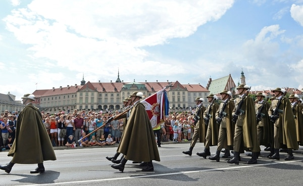 Polish Army soldiers march on one of the city's main streets during a yearly military parade celebrating the Polish Army Day in Warsaw, Poland, Wednesday, Aug. 15, 2018, with the Royal Castle in the background. (AP Photo/Alik Keplicz)