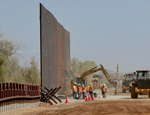 Government contractors erect a section of Pentagon-funded border wall along the Colorado River, Tuesday, Sept. 10, 2019 in Yuma, Ariz. (Matt York/AP)