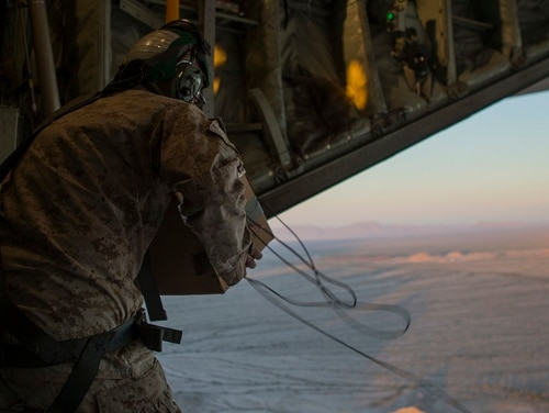 Sgt. Taylor P. Baker, military information support operations (MISO) specialist with Marine Corps Information Operations Center prepares to drop sanitized leaflets from a KC-130J Super Hercules during Weapons and Tactics Instructor course (WTI) 1-17 in Yuma, Arizona, Oct. 22, 2016. (Lance Cpl. Andrew Huff/Navy)