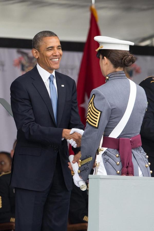U.S Military Academy @WestPoint_USMA May 28 President Obama presents #WestPoint Class of 2014 valedictorian, Cadet Erin Mauldin, her diploma.