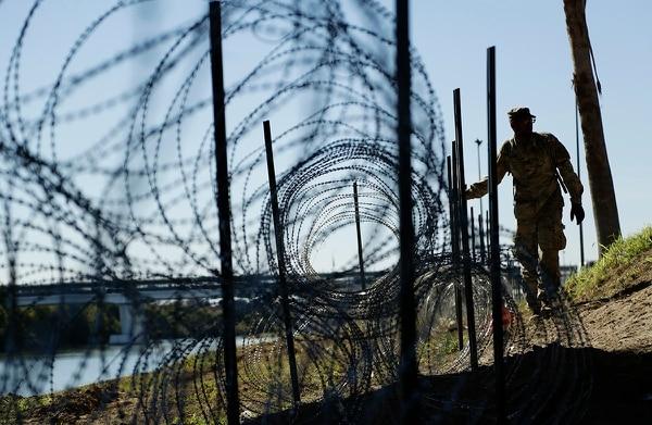 Members of the U.S. military install concertina wire along the banks of the Rio Grande near the Juarez-Lincoln Bridge at the U.S.-Mexico border, Friday, Nov. 16, 2018, in Laredo, Texas. (Eric Gay/AP)