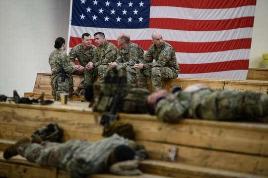 Paratroopers from the 82nd Airborne Division wait at Fort Bragg's Green Ramp before a deployment to Kuwait on Jan. 4, 2020. (Andrew Craft/Getty Images)