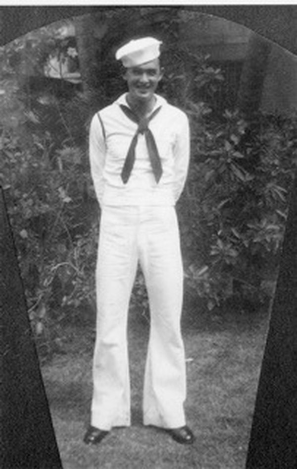 This photo provided by retired U.S. Navy Cmdr. Don Long shows Long in his Navy uniform in 1941. Now, 77 years later, Long remembers that day and tells how he escaped a burning plane and swam beneath flames to get away, ducking into the water to hide every time a Japanese plane made a pass overhead. (Don Long via AP)