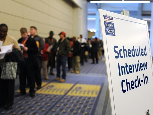 Veterans wait in line at a federal career fair in Washington in January 2012. (Department of Veterans Affairs)