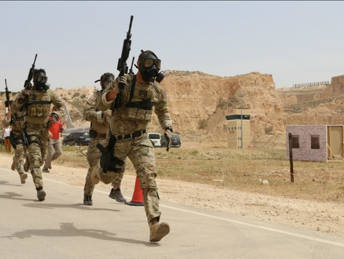Soldiers with Special Operations Command Forward–Jordan sprint toward their objective during a chemical, biological, radioactive and nuclear weapons scenario as part of the 2017 Annual Warrior Competition in Amman, Jordan. (Sgt. 1st Class Kenneth Upsall/Army)