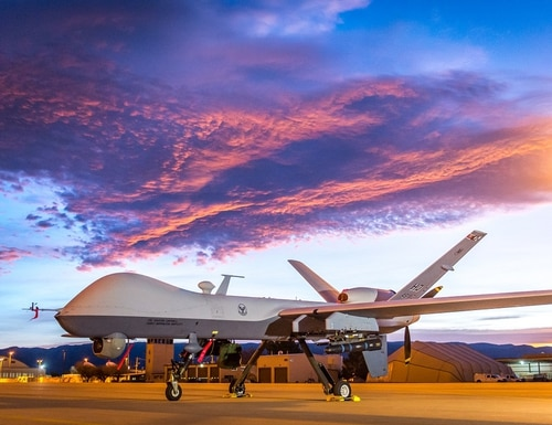 The sun rises over an MQ-9 Reaper remotely piloted aircraft at Holloman Air Force Base, N.M., Dec. 16, 2016. (J.M. Eddins Jr./U.S. Air Force)