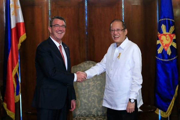 Philippine President Benigno Aquino III, right, greets U.S. Defense Secretary Ash Carter during his courtesy call at the Malacanang presidential palace in Manila, Philippines on Thursday, April 14, 2016. Carter is in the country as US and Philippine forces participate in a joint military exercise called shoulder-to-shoulder or