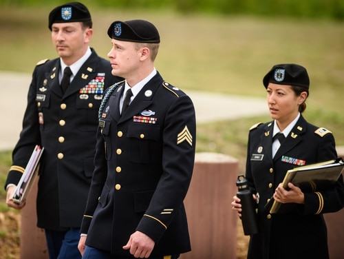 Army Sgt. Bowe Bergdahl, center, arrives at the Fort Bragg courtroom facility for an arraignment hearing on Tuesday, May 17, 2016. (Andrew Craft/The Fayetteville Observer via AP)