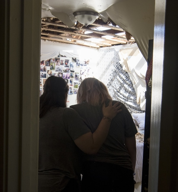Sonia and Zoe Reeves react to the damage to their home on Oct. 17, 2018 at Tyndall Air Force Base, Florida, after Hurricane Michael stuck the base one week ago. Support personnel from Tyndall and other bases were on location to support Airmen returning to their homes to assess damage and collect personal belongings. (Kelly Walker/Air Force)