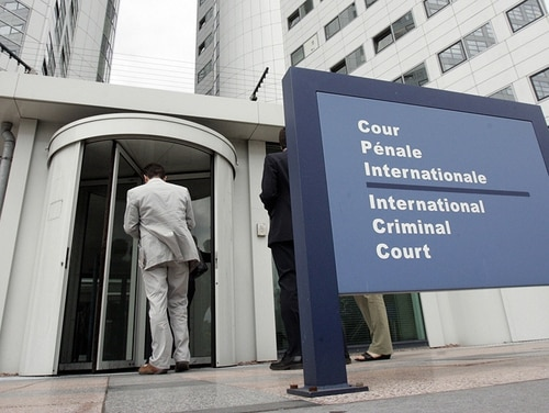 People enter the International Criminal Court on June 20, 2006, at the Hague. (AFP via Getty Images)