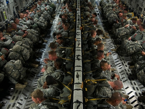 U.S. Army paratroopers wait for takeoff in an Air Force C-17A Globemaster III aircraft June 27, 2013, before an airdrop as part of Joint Operational Access Exercise (JOAX) 13-03 at Pope Field, Fort Bragg, N.C. (Tech. Sgt. Bradley C. Church/Air Force)