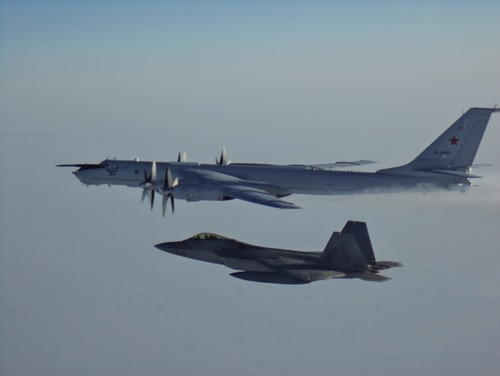 North American Aerospace Defense Command F-22s, CF-18s, supported by KC-135 Stratotanker and E-3 Sentry AWACS aircraft, intercepted two Russian Tu-142 maritime reconnaissance aircraft entering the Alaskan Air Defense Identification Zone on Monday, March 9. (NORAD)