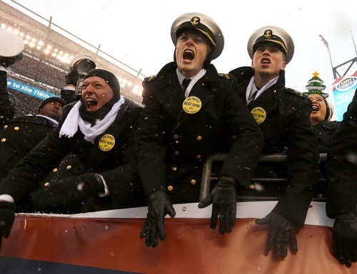 Navy Midshipmen cheer as the 118th Army-Navy game gets underway Saturday in Philadelphia. (Jacqueline Larma/AP)