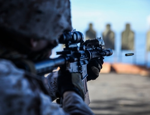 U.S. Marine Sgt. Justin Leduc shoots at his target aboard the USS Essex (LHD 2) at sea in the Pacific Ocean, June 1, 2015. Leduc is a military policeman with Law Enforcement Detachment, Combat Logistics Battalion 15, 15th Marine Expeditionary Unit. He is also an enabler with the 15th Marine Expeditionary Unit's Maritime Raid Force. The law enforcement Marines assist the MRF with tactical site exploitation during their missions. (U.S. Marine Corps photo by Cpl. Anna Albrecht/Released)