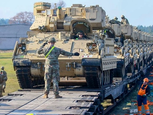 U.S. soldiers unload heavy combat equipment including Abrams tanks and Bradley fighting vehicles at the railway station near the Pabrade military base in Lithuania, on October 21, 2019. (Petras Malukas/AFP via Getty Images)