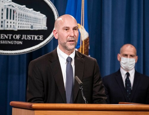 Steven D'Antuono, head of the FBI Washington field office, speaks as acting U.S. Attorney Michael Sherwin, right, listens during a news conference Tuesday, Jan. 12, 2021, in Washington. (Sarah Silbiger/Pool via AP)