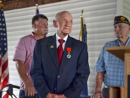 WWII veteran Jimmie H. Royer attends the ceremony where he was awarded France's Legion of Honor at VFW Post 346 in Terre Haute, Ind., Sunday, Sept. 29, 2019. (Austen Leake/The Tribune-Star via AP)