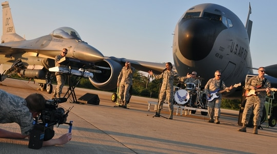 Military bands like Max Impact, seen here recording a music video, surfaced at some point after we split into an alternate timeline. (Staff Sgt. Kat Lynn Justen/Air Force)