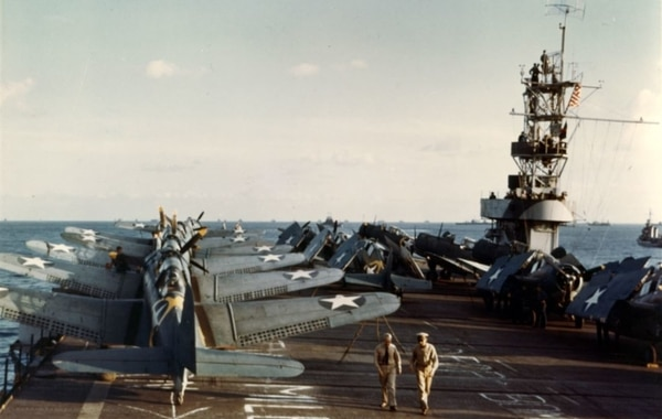 The escort carrier Santee with Douglas SBD-3 Dauntless scout-bombers and Grumman F4F-4 Wildcat fighters on the flight deck during Operation Torch. (National Archives)