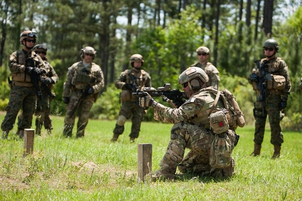 A U.S. Special Forces soldier works with his Chilean counterparts at the Camp Shelby, Miss. The two-star in charge of training Green Berets has responded to a scathing letter accusing the school of watering down its standards. (Staff Sgt. Osvaldo Equite/Army)