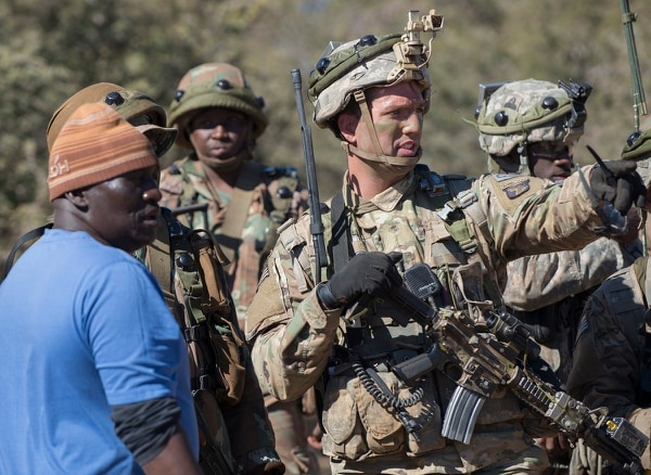 First Lt. Zachary Lewis, a platoon leader with the 101st Airborne Division's 2nd Battalion, 327th Infantry Regiment, speaks to leaders inside a camp for internally displaced people during a scenario at the South African Army Combat Training Center in Lohatla, July 24, 2017. (Sean Kimmons/Army)