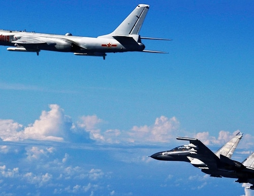 A Chinese People's Liberation Army Air Force Su-30 fighter, right, flies with a H-6K bomber during a drill near the East China Sea in September 2016. The U.S. has a