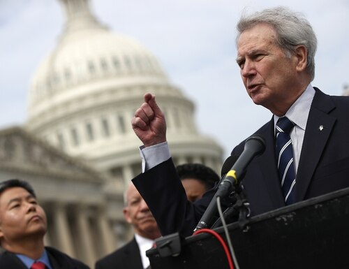 Rep. Walter Jones (right, R-N.C.) speaks during a press conference outside the U.S. Capitol in opposition to the involvement of U.S. military forces in Syria March 21, 2017 in Washington, DC. U.S. members of Congress voiced their concern about