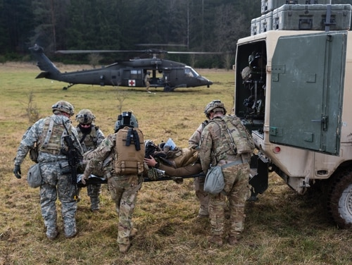 A flight paramedic receives urgent surgical patients during a training exercise on Jan. 27, 2020. (Sgt. 1st Class Garrick W. Morgenweck/Army)