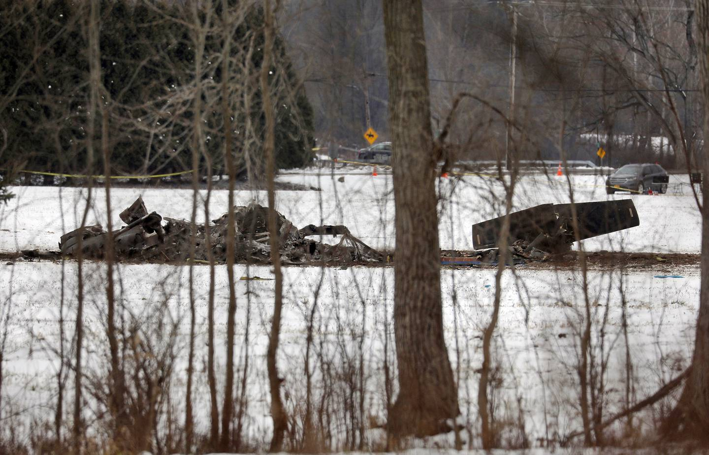The wreckage of a UH-60 Black Hawk medical evacuation helicopter sits in a field in Mendon, NY., Thursday, Jan. 21, 2021.