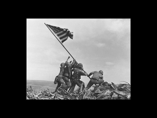 U.S. Marines of the 28th Regiment, 5th Division, raise the American flag atop Mt. Suribachi, Iwo Jima, on Feb. 23, 1945. (Joe Rosenthal/AP)