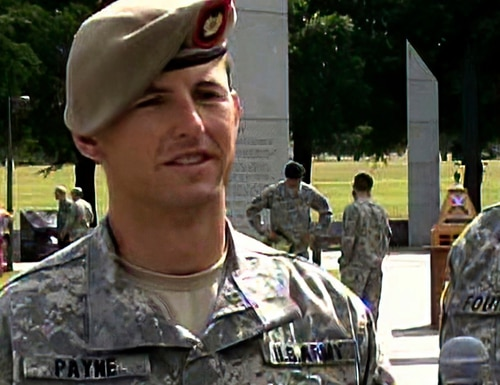 In this image from video provided by the U.S. Army, then-Sgt. 1st Class Thomas Payne is interviewed as a winner of the 2012 Best Ranger competition at Fort Benning, Ga., on April 16, 2012. (Lori Egan/Army via AP)