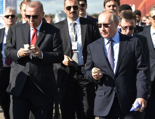 Russian President Vladimir Putin, right, and Turkish President Recep Tayyip Erdogan eat ice cream as they visit the MAKS air show in Russia on Aug. 27, 2019. (Alexey Nikolsky/AFP via Getty Images)
