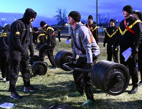 A soldier at Fort Knox, Kentucky, attempts to deadlift more than 200 pounds during a training session for the new Army Combat Fitness Test. (Eric Pilgrim/Fort Knox)