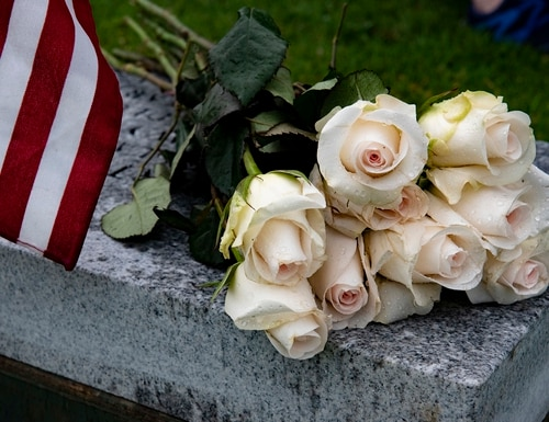 Flowers lay on a bench during a funeral at the National Memorial Cemetery of the Pacific, Honolulu, March 17, 2020. (Staff Sgt. Jamarius Fortson/Army)