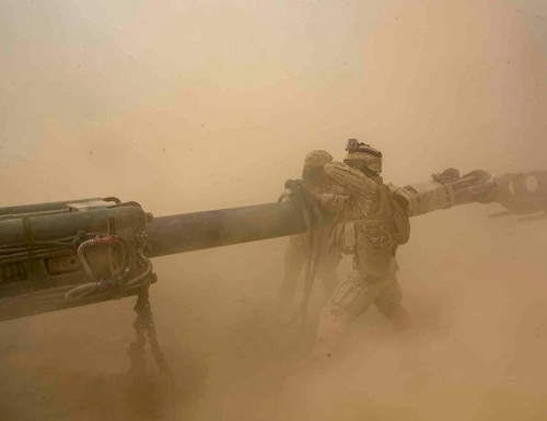Lance Cpl. Mauricio Tinoco, right, and Lance Cpl. Isabel Rodriguez prepare to rig an M777A2 155mm Howitzer onto a CH-53E Super Stallion during a day battle drill at the Chocolate Mountain Aerial Gunnery Range, Calif., April 3, 2021. (Cpl. KarlHendrix Aliten/Marine Corps)