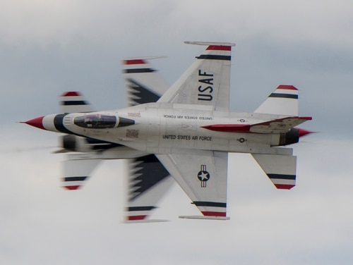 The U.S. Air Force Air Demonstration Squadron, the Thunderbirds, perform over the skies of Rocherster, N.Y., Aug. 24, at the Rochester International Air Show. An air show at Laughlin Air Force Base, which was to feature the Thunderbirds, has been canceled due to coronavirus concerns. (Maj. Ray Geoffroy/Air Force)