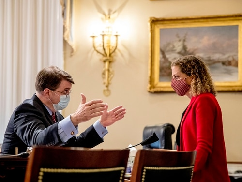 VA Secretary Robert Wilkie, left, speaks with Rep. Debbie Wasserman Schultz, D-Fla., right, following a House Appropriations Committee hearing on Capitol Hill on May 28, 2020. (Andrew Harnik/AP)