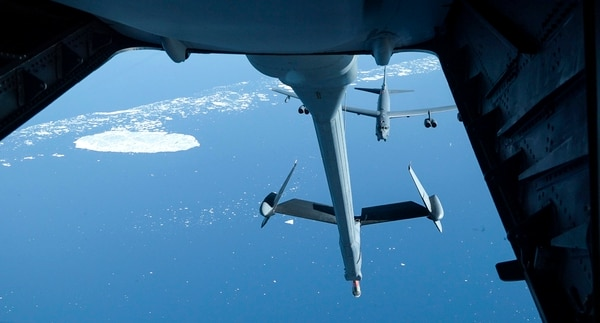A B-52 slowing pulls up to the boom of a KC-10 Extender aerial refueling tanker from the 32nd Air Refueling Squadron at Joint Base McGuire-Dix-Lakehurst in NJ, while flying over international airspace between Greenland and Canada in the arctic on Sunday, July 31, 2016. This was part of Operation Arctic Roar, a U.S. Strategic Command operation designed to strengthen bomber crews' interoperability and demonstrate ability for the U.S. bomber force to provide flexible and vigilant long-range global-strike capability. On the return flight, the flight of 4 KC-10's practiced refueling between the tanker planes. (Alan Lessig/Staff)