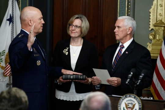 Vice President Mike Pence, right, swears in Air Force Gen. John Raymond, left, as chief of space operations on Jan. 14. (Steve Helber/AP)