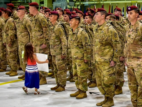 A child can't wait for ceremonial proceedings to end before greeting a loved one at Joint Base Elmendorf-Richardson, Alaska, June 2, as nearly 400 paratroopers with 4th Infantry Brigade Combat Team, 25th Infantry Division return from a nine-month deployment to Afghanistan. (John Pennell/Army)