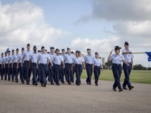 Airmen march in a basic military training graduation ceremony in 2015. The Air Force has barred family members from attending BMT graduation ceremonies as part of its efforts to minimize the spread of coronavirus. (Joshua Rodriguez/Air Force)