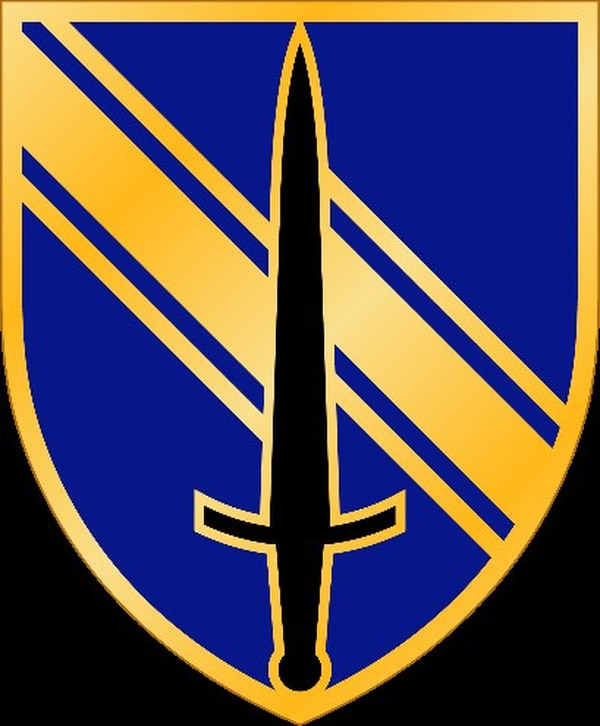 The unit insignia for the Army's new Security Force Assistance Brigade features a gold shield with a black sword pointing upwards. (Army)