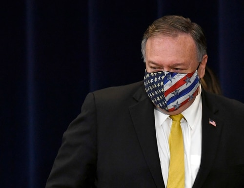 Secretary of State Mike Pompeo walks off of the stage following a news conference at the State Department in Washington, Wednesday, Aug. 19, 2020, with Iraqi Foreign Minister Fuad Hussein. (Susan Walsh/AP)