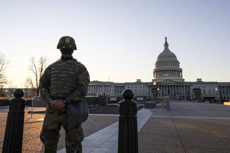 National Guard troops stand guard at the U.S. Capitol on Jan. 12, 2021, in Washington.